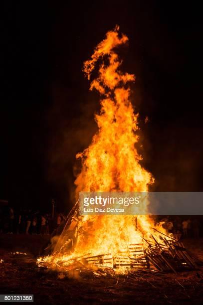 2017 festivities of saint juan - fireman fighting fire - bonfire stock photos and pictures