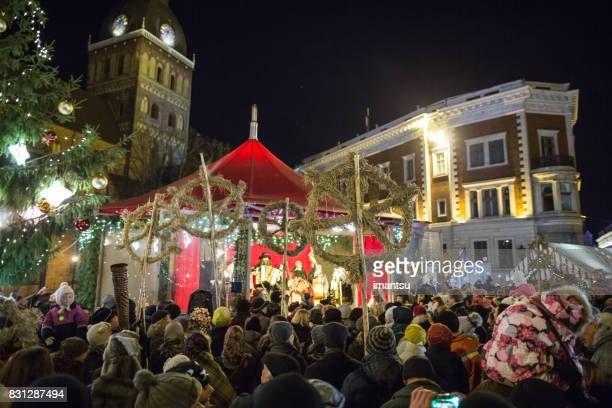 festivities participants dome square in the old town - yule log stock pictures, royalty-free photos & images