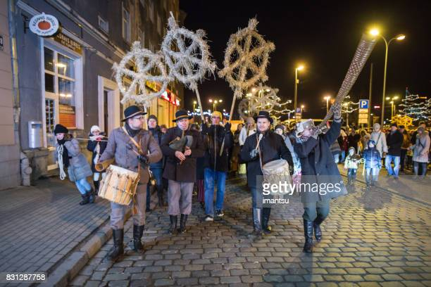 festivities participants in the streets of old riga - yule log stock pictures, royalty-free photos & images