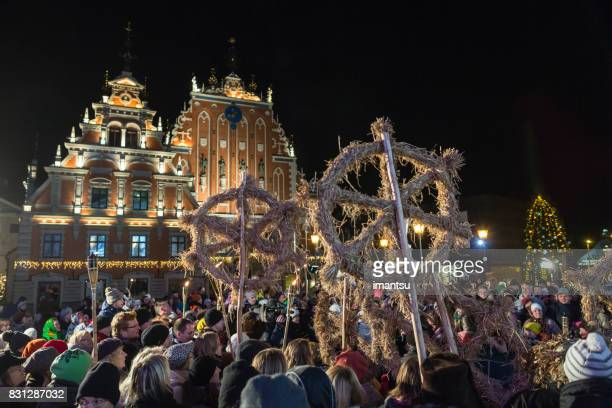 festivities participants in the town hall square in old riga - yule log stock pictures, royalty-free photos & images