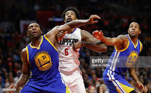Festus Ezeli of the Golden State Warriors Andre Iguodala of the Golden State Warriors and DeAndre Jordan of the Los Angeles Clippers battle for...