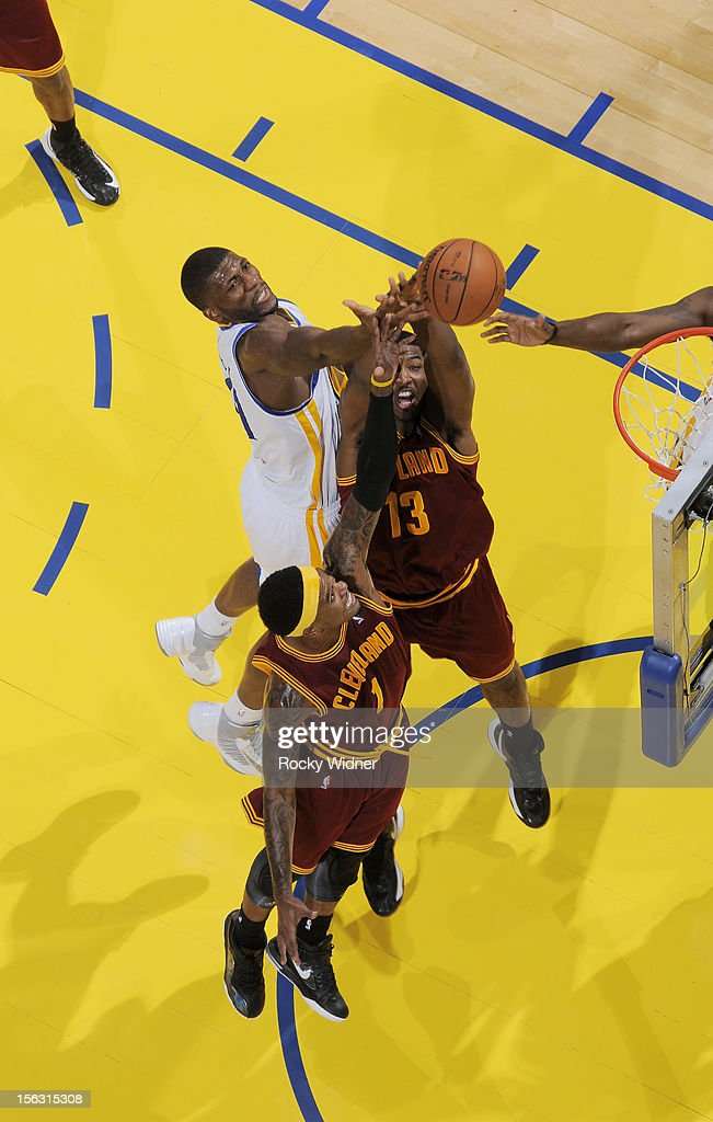 Festus Ezeli #31 of the Golden State Warriors attempts to grab the ball away from Tristan Thompson #13 and Daniel Gibson #1 of the Cleveland Cavaliers on November 7, 2012 at Oracle Arena in Oakland, California.