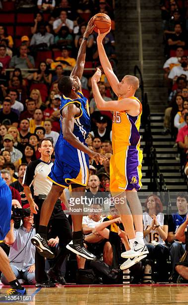 Festus Ezeli of the Golden State Warriors blocks the shot against Greg Somogyi of the Los Angeles Lakers during a preseason game at the Save Mart...