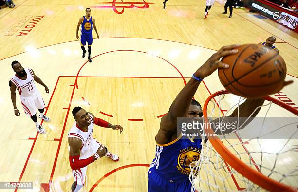 Festus Ezeli of the Golden State Warriors dunks against the Houston Rockets in the first half during Game Four of the Western Conference Finals of...