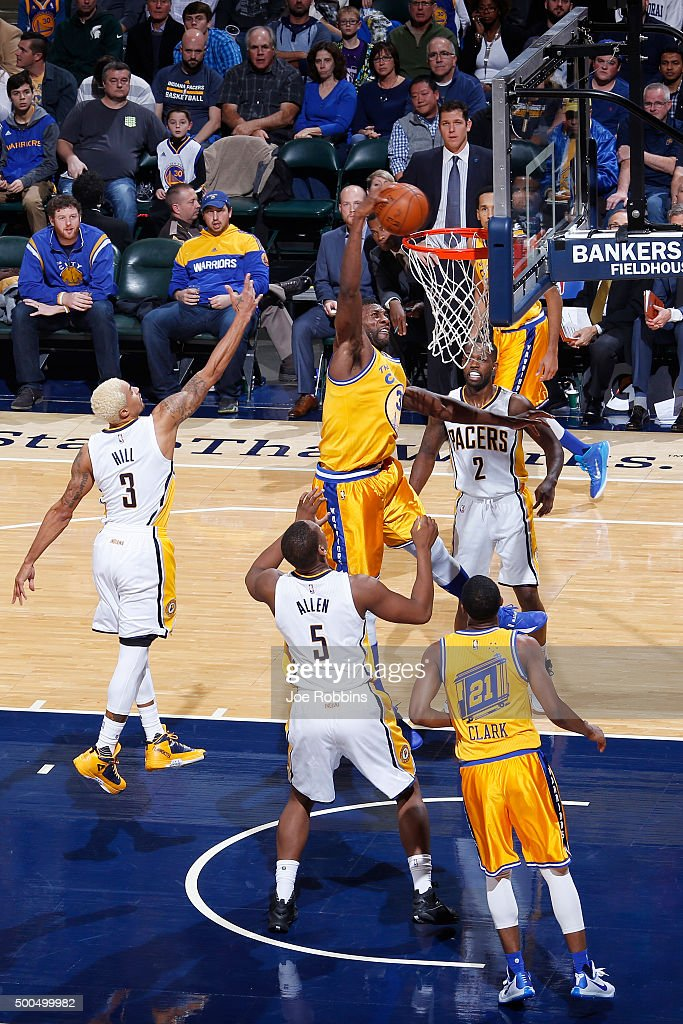 Festus Ezeli #31 of the Golden State Warriors dunks the ball against Lavoy Allen #5 and George Hill #3 of the Indiana Pacers in the first half of the game at Bankers Life Fieldhouse on December 8, 2015 in Indianapolis, Indiana. The Warriors defeated the Pacers 131-123 to move to 23-0 on the season.