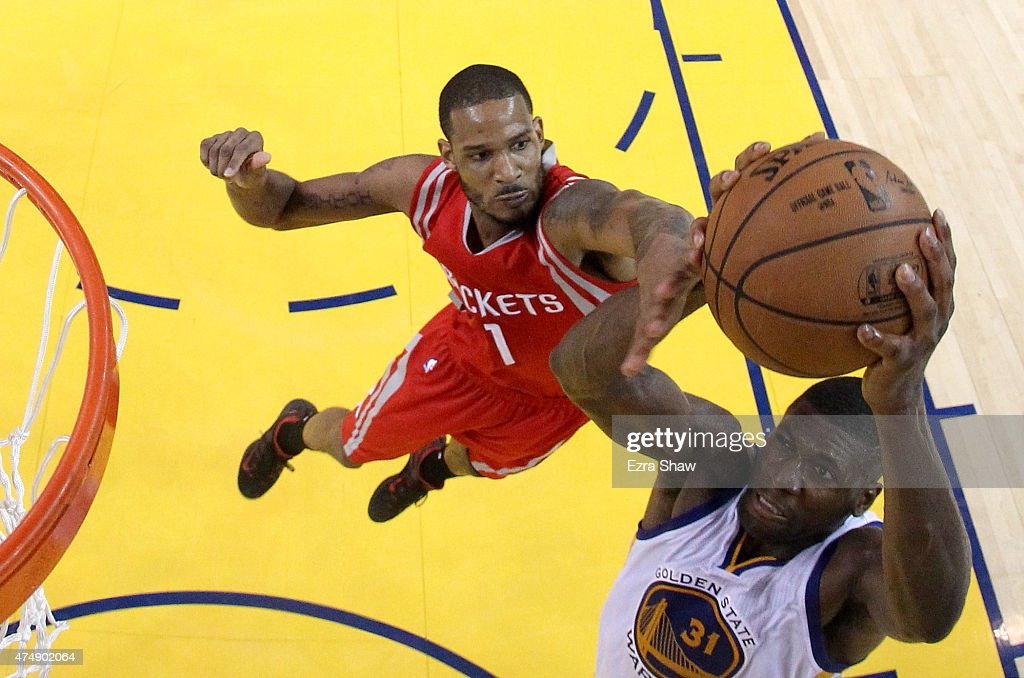 Festus Ezeli #31 of the Golden State Warriors goes up for a dunk against Trevor Ariza #1 of the Houston Rockets in the first half during game five of the Western Conference Finals of the 2015 NBA Playoffs at ORACLE Arena on May 27, 2015 in Oakland, California.