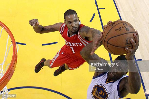 Festus Ezeli of the Golden State Warriors goes up for a dunk against Trevor Ariza of the Houston Rockets in the first half during game five of the...
