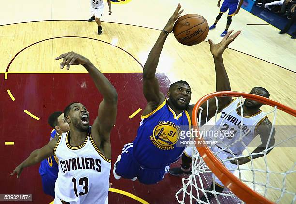 Festus Ezeli of the Golden State Warriors grabs a rebound in front of Tristan Thompson of the Cleveland Cavaliers in the first half in Game 4 of the...