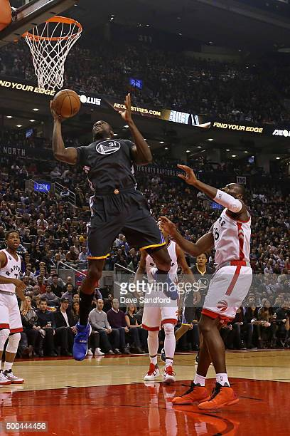 Festus Ezeli of the Golden State Warriors grabs the rebound against the Toronto Raptors on December 5 2015 at Air Canada Centre in Toronto Ontario...