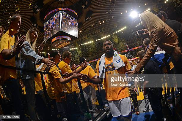 Festus Ezeli of the Golden State Warriors shakes the hands of fans as he walks to the locker room after Game Five of the Western Conference Finals...