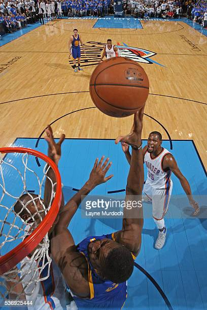 Festus Ezeli of the Golden State Warriors shoots the ball against the Oklahoma City Thunder during Game Three of the NBA Western Conference Finals on...