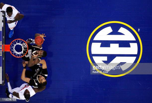 Festus Ezeli of the Vanderbilt Commodores rebounds against the Florida Gators during the semifinals of the SEC Men's Basketball Tournament at Georgia...