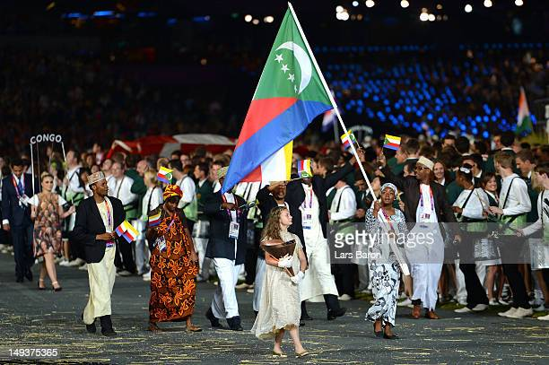 Feta Ahamada of the Comoros Olympic athletics team carries her country's flag during the Opening Ceremony of the London 2012 Olympic Games at the...