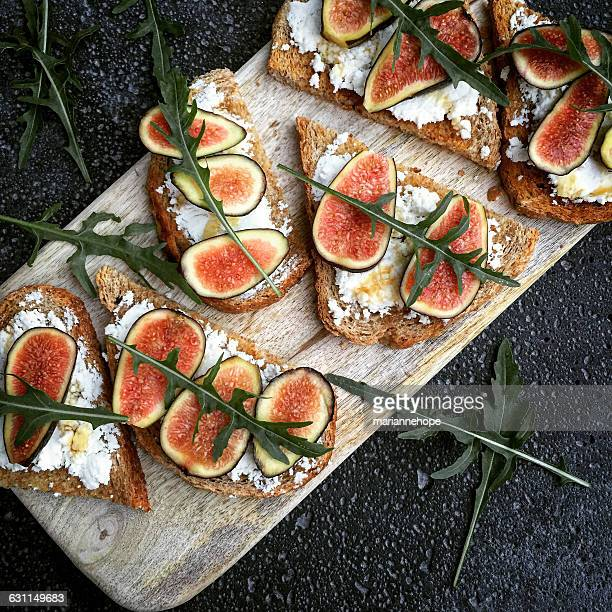 feta and fig toasts - greek food stock pictures, royalty-free photos & images