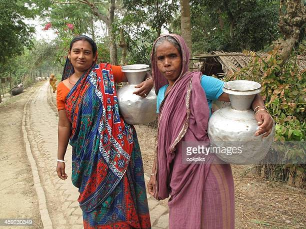fetching water in bangladesh - bangladesh stock photos and pictures