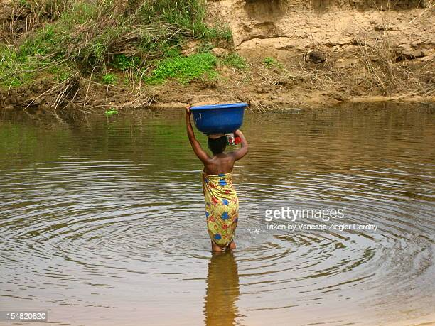 fetching water - gold coast stock pictures, royalty-free photos & images