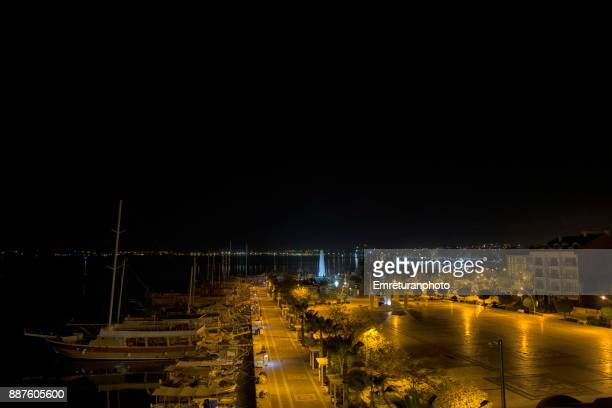 fethiye harbor seafront square view at night. - emreturanphoto stock pictures, royalty-free photos & images