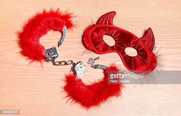 fetisch mask and handcuffs - sex toy stock photos and pictures
