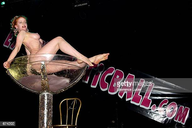 Fetish artist Catherine D''Lish takes a bath in a giant Martini glass during the Exotic Erotic Ball at Webster Hall November 28 2001 in New York A...