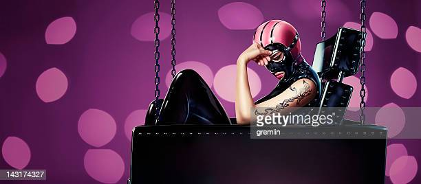 fetish woman in leather sofa - fetish wear stock photos and pictures