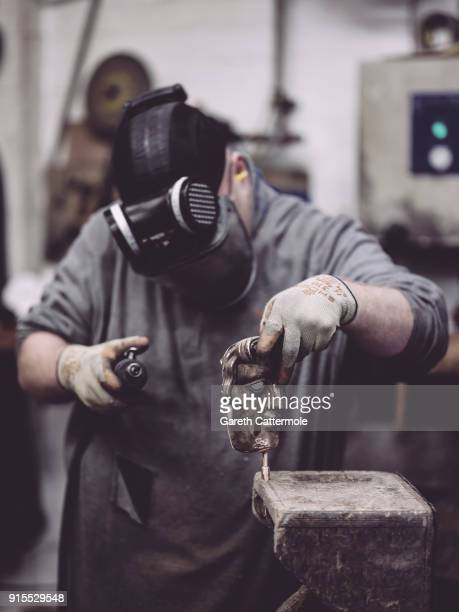 Fetler Anthony Phillips works during the BAFTA masks casting at New Pro Foundries Ltd on February 7 2018 in London England The EE British Academy...