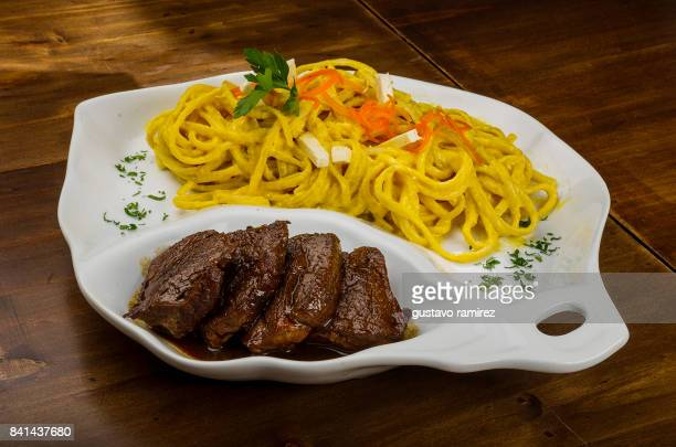 fettuccine with fried loin - lima animal stock pictures, royalty-free photos & images