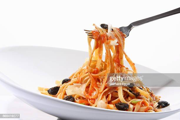 Fettuccini pasta with tomato sauce and olives