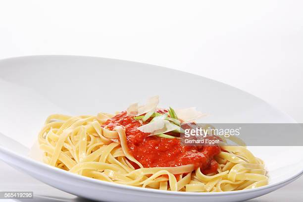 fettuccini pasta with tomato sauce - gerhard egger stock pictures, royalty-free photos & images