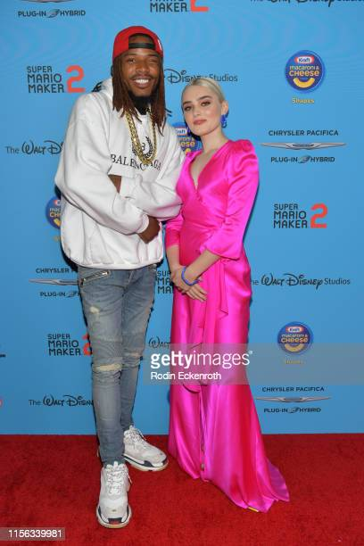 Fetty Wap and Meg Donnelly attend 2019 Radio Disney Music Awards at CBS Studios Radford on June 16 2019 in Studio City California