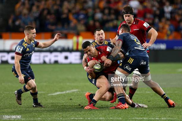 Fetuli Paea of the Crusaders is tackled during the round 4 Super Rugby Aotearoa match between the Highlanders and the Crusaders at Forsyth Barr...
