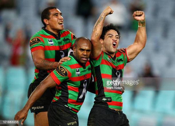 Fetuli Talanoa, Rhys Wesser and Issac Luke of the Rabbitohs celebrate a try by Issac Luke during the round 13 NRL match between the South Sydney...