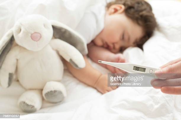 feverish baby sleeping - fever stock pictures, royalty-free photos & images