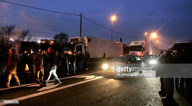 Few cars pass by parked trucks blocking North Rome's motorway 11 December 2007 Italian truck drivers launched a fiveday strike 10 december 2007 in...