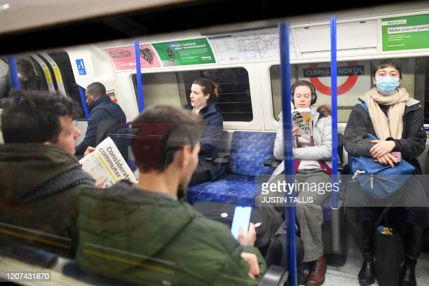 Few commuters travel on the metro train during the morning rush hour time of 0830 from Clapham North to central London on March 17 2020 Britain...