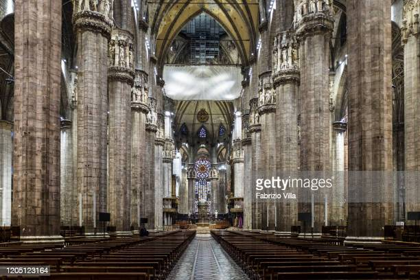Few faithful and tourists in the Duomo of Milan on March 4 2020 in Milan Italy The Duomo of Milan reopened to the public after a week of closure for...