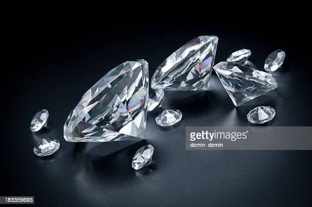 Few, huge diamonds scattered on black background