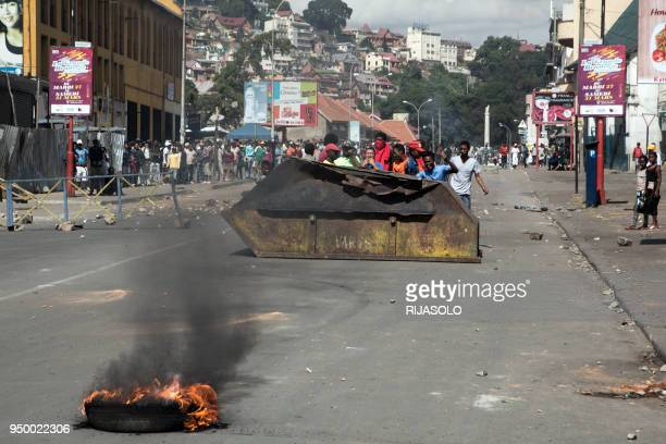 Few hundred people gather in the centre of Antananarivo on April 22, 2018 to erect a roadblock, during a rally to protest against the new electoral...