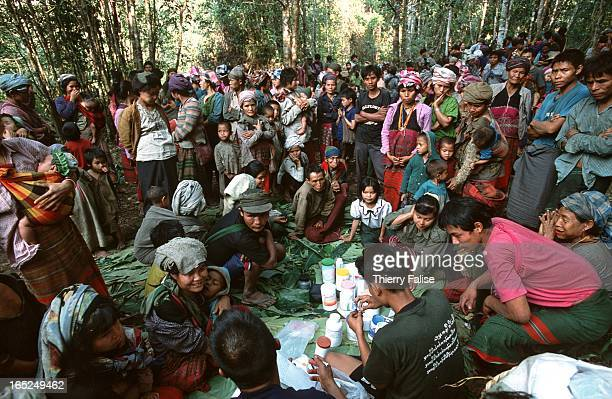 A few hundreds Karen and Karenni refugees gather in a jungle clearing where a team of the Free Burma Rangers is organizing a consultation cabinet