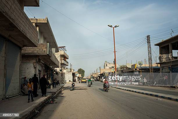 Few locals seen on the streets around mostly shuttered shops in Tel Abyad Syria