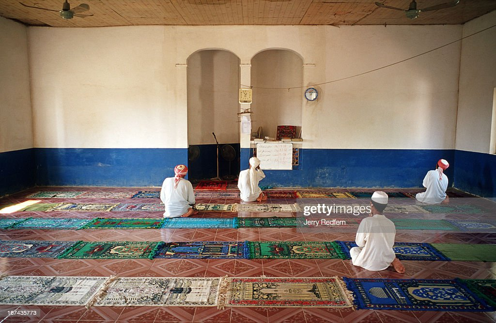 A few men continue praying following Friday prayers at the Nour el Essan Mosque in Chong Koh village. The village consists of poor fishing families and a few farmers and traders..