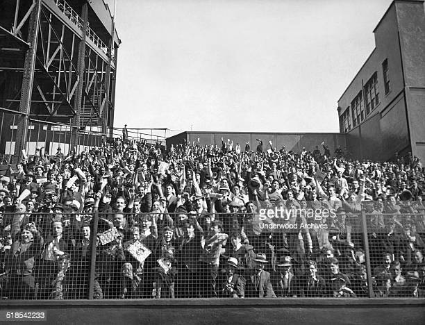 A few of the 56000 fans at the baseball season's opening day game between the New York Giants and the Brooklyn Dodgers at the Polo Grounds New York...