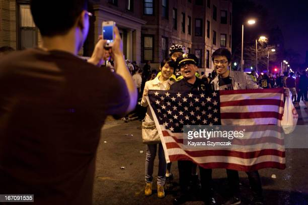A few of the estimated 200 people who poured onto Hemingway Street in the Fenway neighborhood to celebrate after the announcement earlier of the...