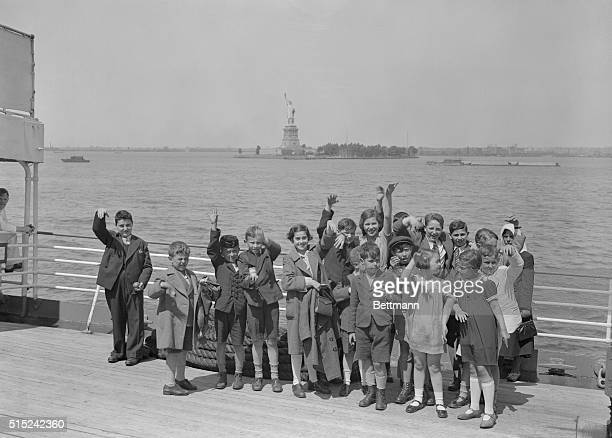 Few of the fifty child refugees from Nazi Germany who entered the United States today under the wing of Gilbert J. Kraus, wealthy Philadelphia...