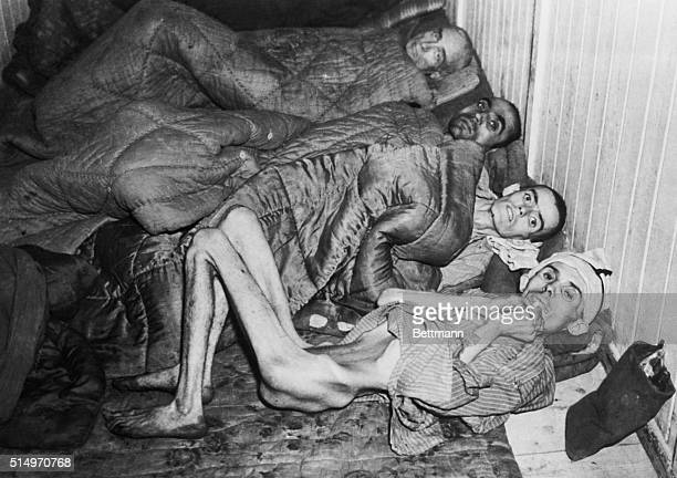 A few of the liberated prisoners of Buchenwald Concentration Camp still showing evidence of horrific mistreatment and starvation The man at the...
