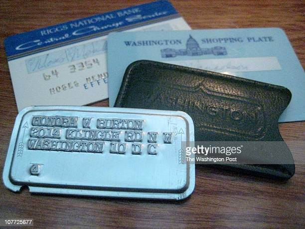 A few old DCcentric credit cards including the original metal Washington Shopping Plate and the plastic Washington Shopping Plate and Central Charge...