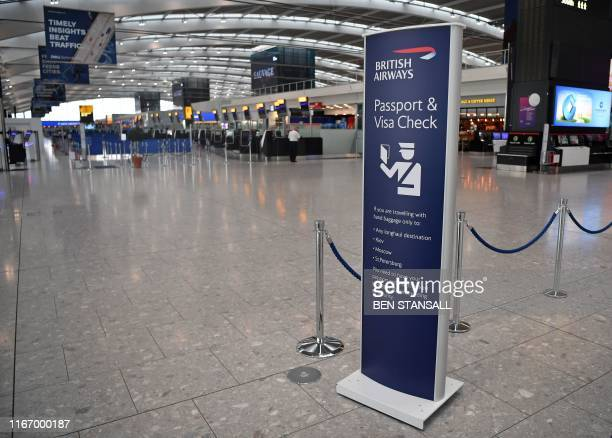 A few passengers walk around the neardeserted departure area at Heathrow airport Terminal 5 in west London on September 9 as the airline's firstever...