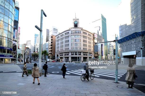 Few people are seen a nearly empty street after the state of emergency declared to prevent the spread of coronavirus in Tokyo Japan on April 102020