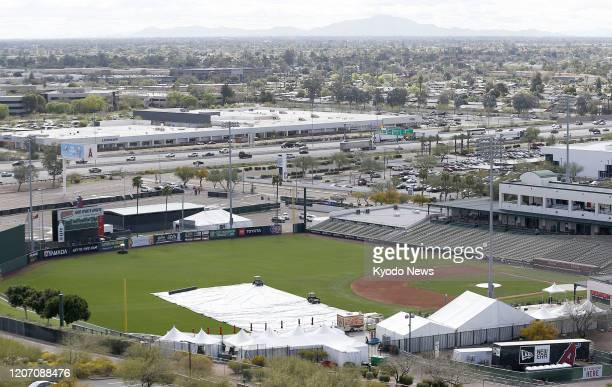 Few people are seen at a ballpark used by the Los Angeles Angels for spring training in Tempe Florida on March 13 2020 Major League Baseball decided...