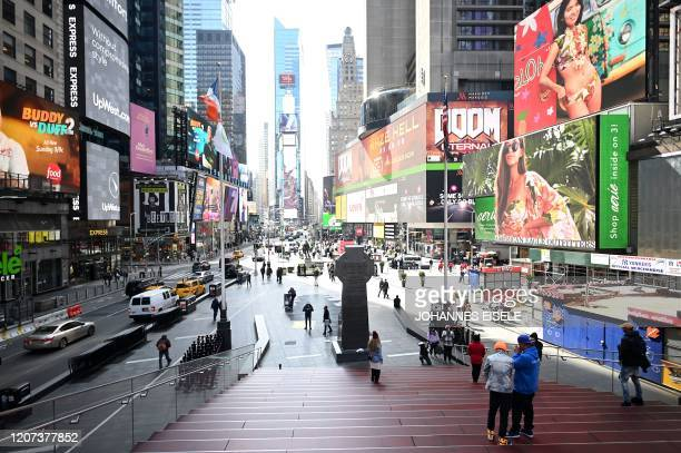 Few people are seen at Times Square in Manhattan on March 16 2020 in New York City Stocks tumbled on March 16 2020 despite emergency central bank...