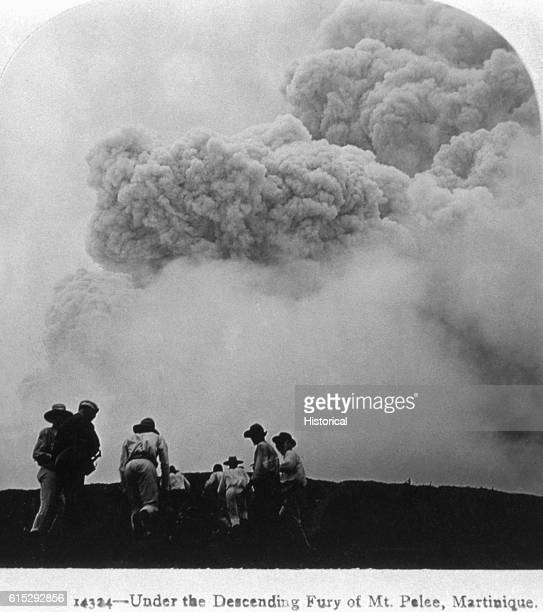 A few people cower before a huge cloud of black smoke and ash during the eruption of Mt Pelee The eruption destroyed a city and killed thousands...
